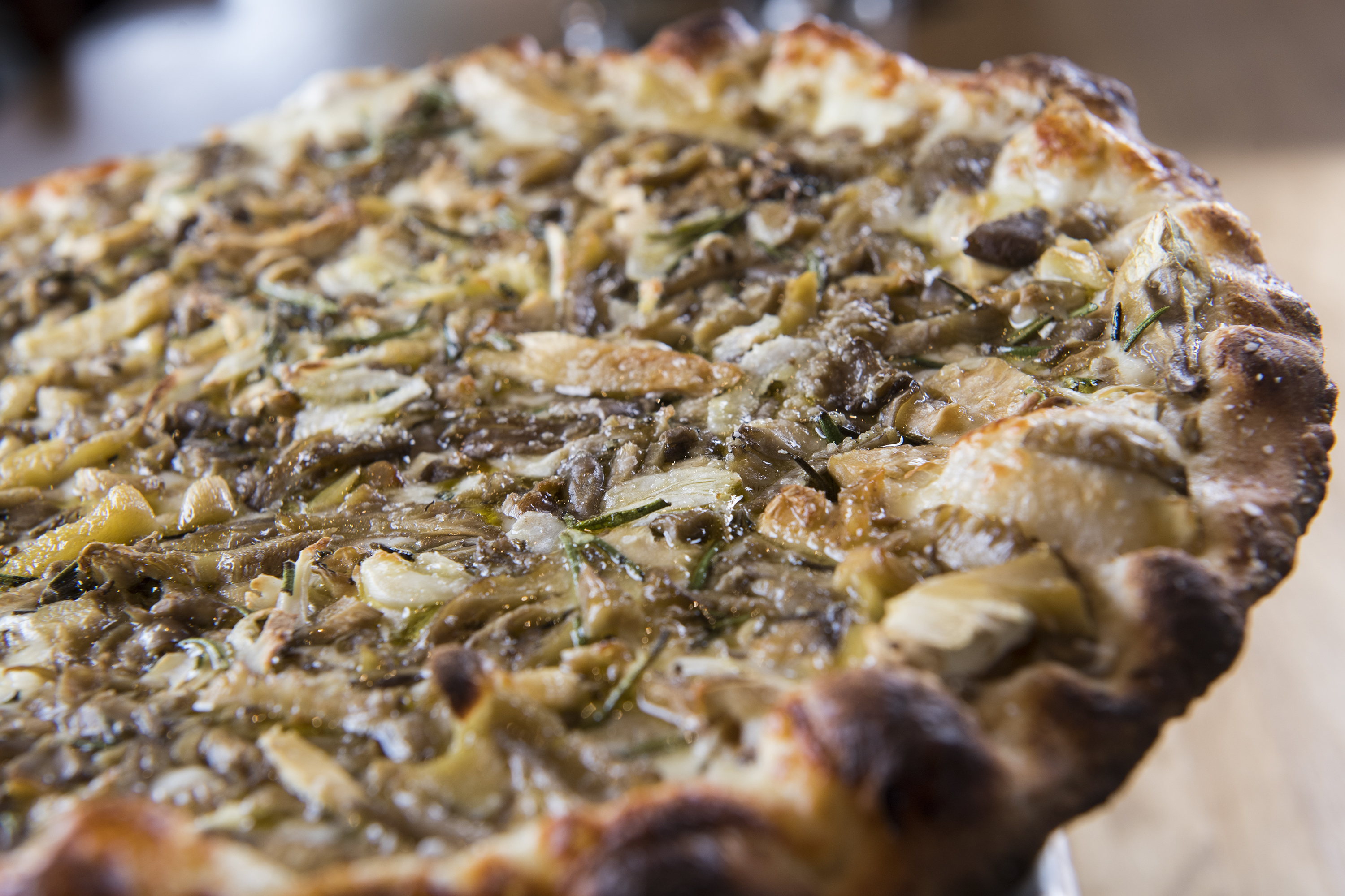 The pies are coal-fired at Black Sheep Pizza. Photo by Issac Hale.