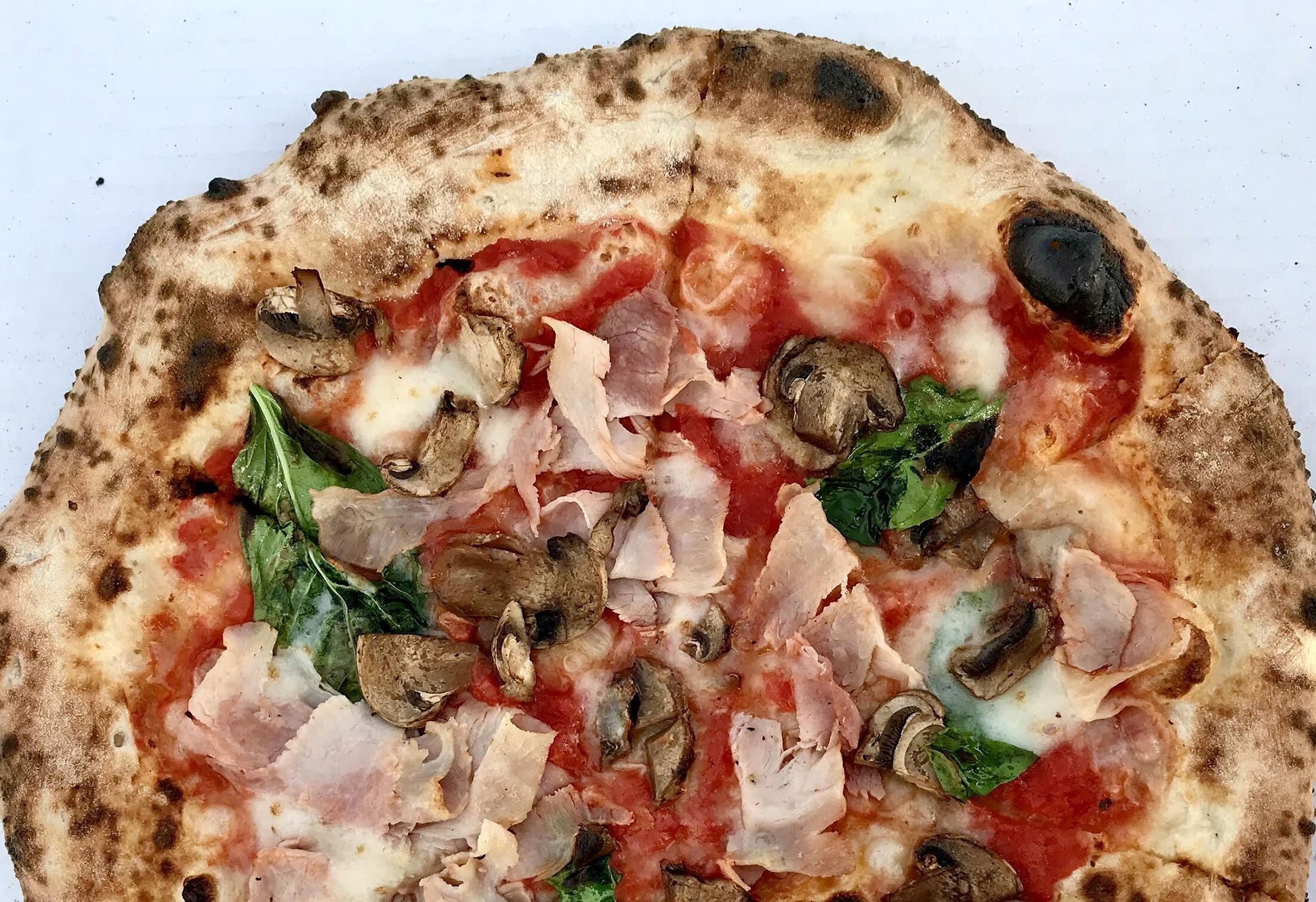 A wood-fired ham and mushroom pizza from Punch. Photo by Rick Nelson.